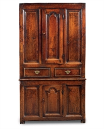 A GEORGE I OAK CUPBOARD