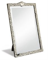 AN EDWARDIAN SILVER-MOUNTED DRESSING TABLE MIRROR