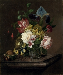 Various flowers in a glass vas