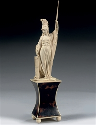 A CARVED IVORY FIGURE OF JUSTI