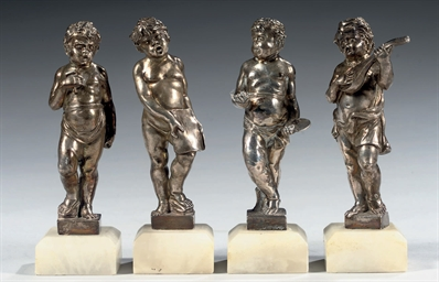 Four cast silver figures