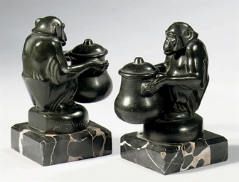 A pair of bronze inkwells