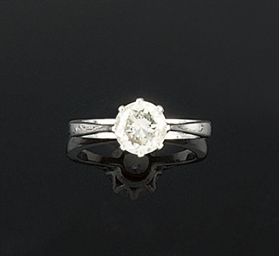 An 18ct gold and diamond singl