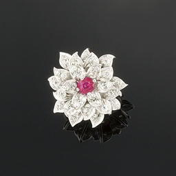 A ruby and diamond flower ring