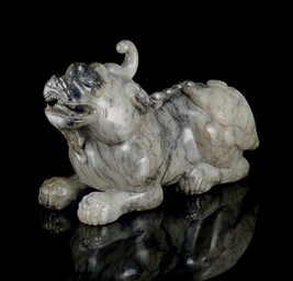 A MOTTLED GREY JADE FIGURE OF