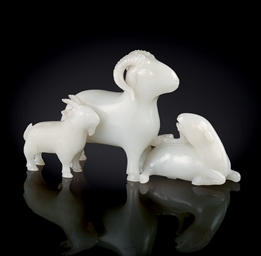 A FINELY CARVED WHITE JADE GRO