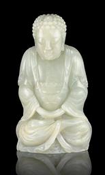 A WHITE JADE FIGURE OF AMITAYU