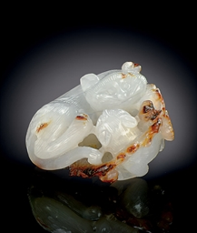 A SMALL WHITE AND RUSSET JADE