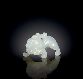 A MINIATURE WHITE JADE FIGURE