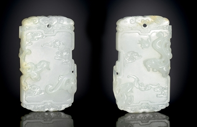 A RARE AND FINELY CARVED WHITE