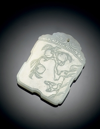 A SMALL WHITE JADE PLAQUE