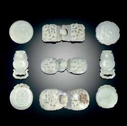 A GROUP OF NINE WHITE JADE PLA
