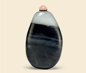 A BLACK AND WHITE JADE PEBBLE