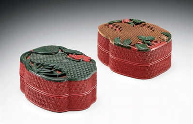 A PAIR OF CARVED LACQUER PLANT