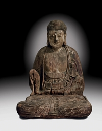 A LARGE WOOD SEATED FIGURE OF