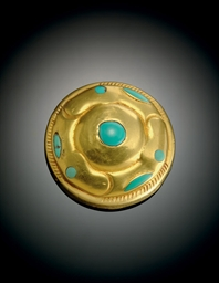 A RARE TURQUOISE-INLAID GOLD C