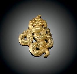A RARE SMALL GOLD OPENWORK ORN