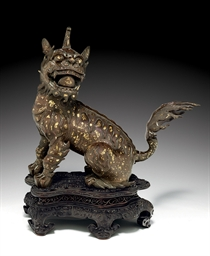 A GOLD-SPLASHED BRONZE FIGURE