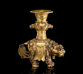 A SMALL EMBELLISHED GILT-BRONZ