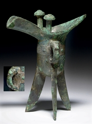 A BRONZE RITUAL TRIPOD WINE VE