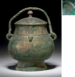 A BRONZE RITUAL WINE VESSEL AN