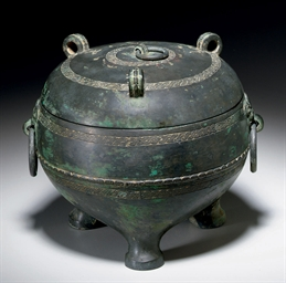 AN UNUSUAL BRONZE TRIPOD RITUA
