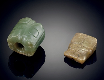 A RARE GREEN JADE ANIMAL MASK