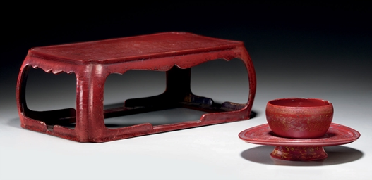 A SMALL RED LACQUER CUP TABLE