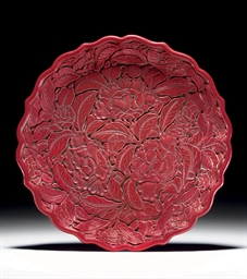 A CARVED RED LACQUER PETAL-LOB