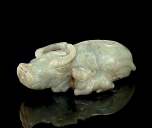 A PALE GREENISH-WHITE JADE WAT