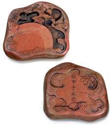 AN UNUSUAL BRICK-RED INKSTONE