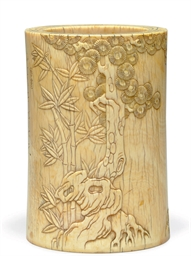 A CARVED IVORY BRUSH POT