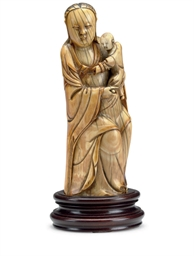 AN IVORY FIGURE OF GUANYIN AND