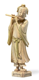 AN IVORY FIGURE OF THE IMMORTA