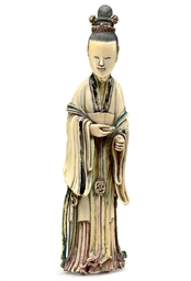 A PAINTED IVORY FIGURE OF A CO