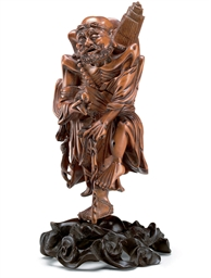 A FINELY CARVED BOXWOOD FIGURE