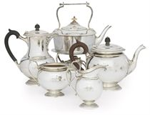 A SCOTTISH SILVER FOUR-PIECE TEA SET WITH ASSOCIATED KETTLE-ON-STAND