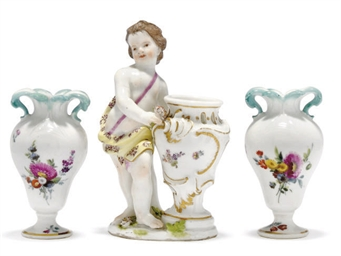 A MEISSEN FIGURE OF A PUTTO AN
