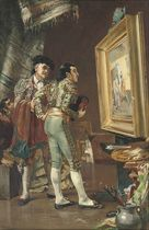 Two matadors discussing a picture of a bullfight