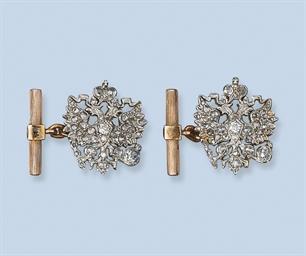 A PAIR OF DIAMOND CUFF LINKS