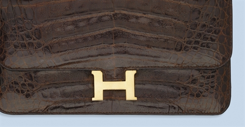 A LEATHER HAND BAG, BY HERMES