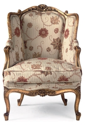 A CARVED GILTWOOD BERGERE