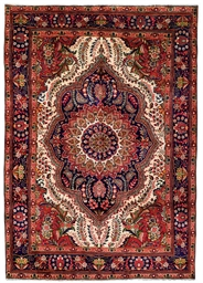 A pair of Tabriz carpets