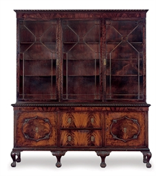 A CARVED MAHOGANY BOOKCASE