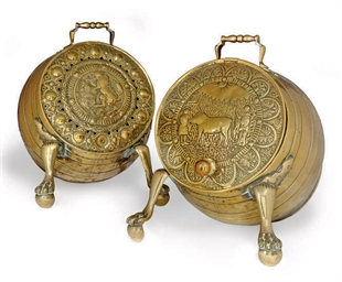 A PAIR OF EMBOSSED BRASS COAL