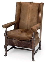 A MAHOGANY WING CHAIR