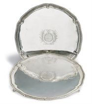 A MATCHED PAIR OF GEORGE III SILVER SALVERS