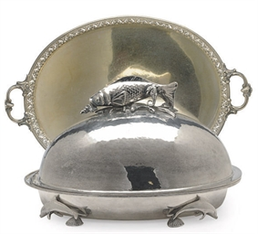 A HAMMERED SILVER PLATE FISH D