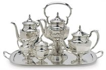 AN AMERICAN SILVER FIVE-PIECE TEA SERVICE AND TEA TRAY,