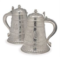 A PAIR OF LARGE AMERICAN SILVER TANKARDS WITH HINGED COVERS,